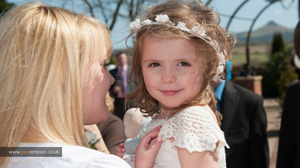 Flower girl attending wedding at the Treebridge Hotel, North Yorkshire