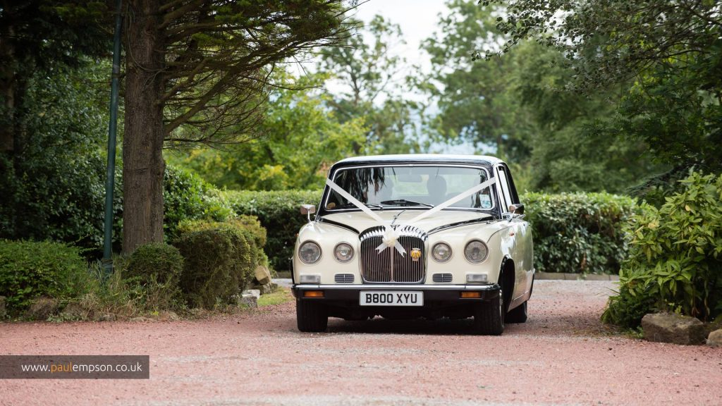 The wedding car arrives at the Treebridge